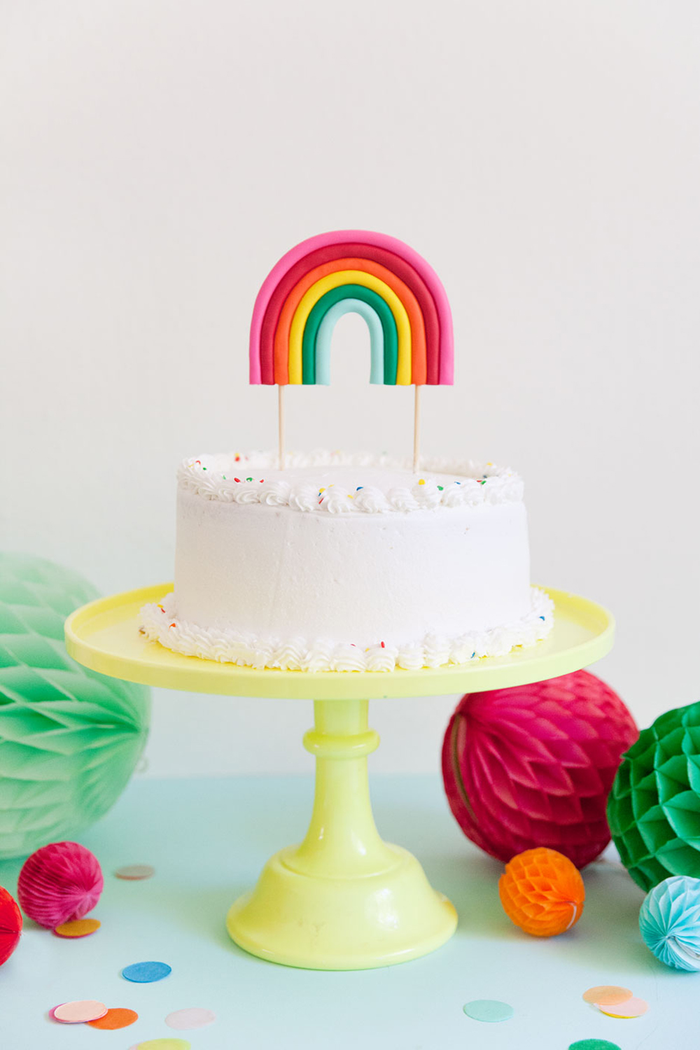 This DIY rainbow cake topper is the cutest and for sure the life of the party. Perfect for any rainbow or unicorn themed birthday parties.