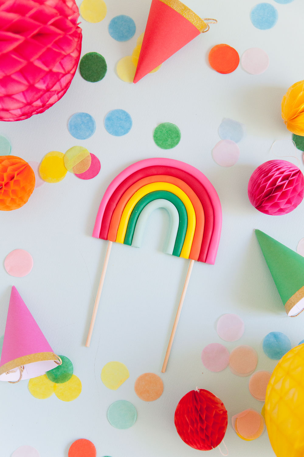 Make this cute DIY rainbow cake topper in a few simple steps. Perfect for any rainbow or unicorn themed birthday parties