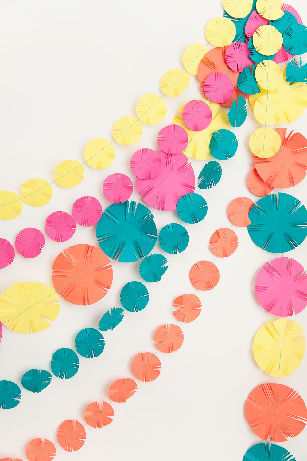 Learn-how-to-make-this-fun-coloful-fringe-garland