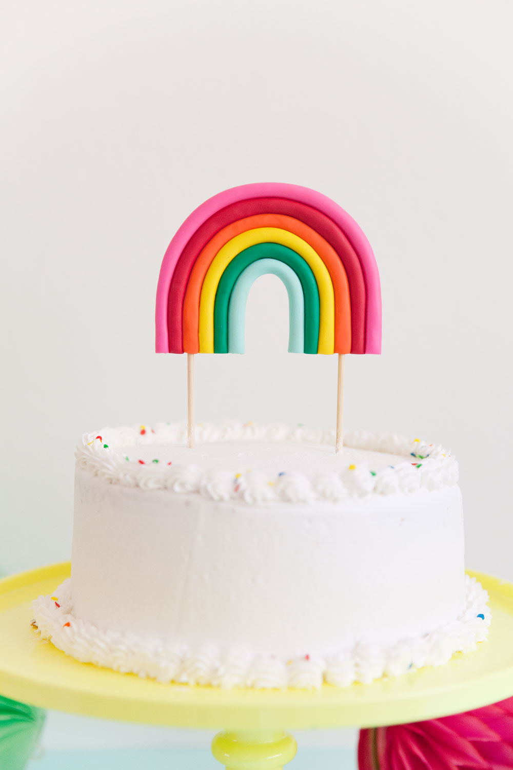 Make this adorable DIY rainbow cake topper! Perfect for any rainbow or unicorn themed birthday parties.
