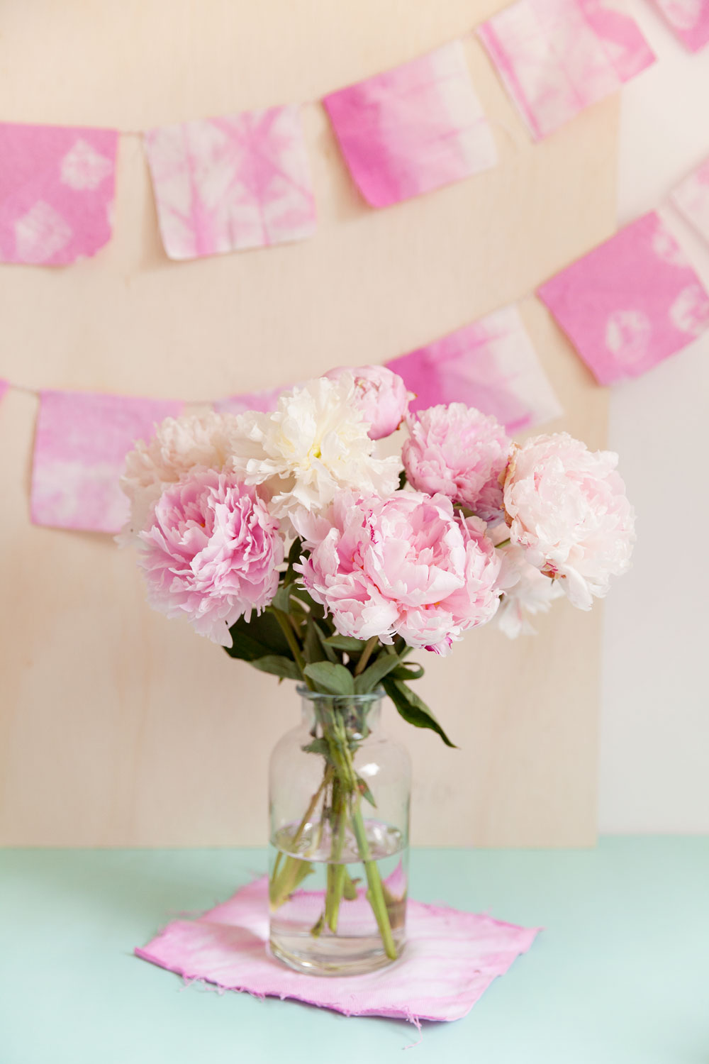 Make this pretty pink Shibori garland! It's perfect for bridal showers, baby showers or any kind of birthday. Its simple to make and oh so pretty. -Banner -DIY -Party -peonies -flowers