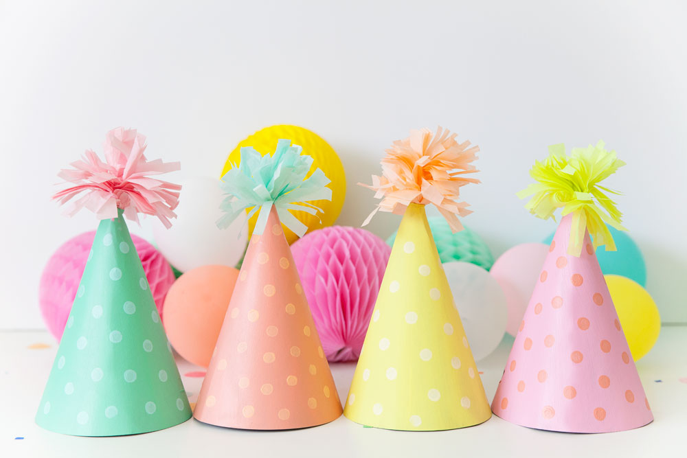 DIY party hats! Learn how to make these adorable pastel party hats which are sure to be a hit!