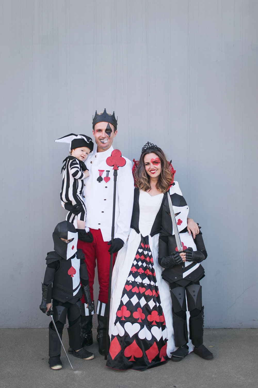 This Queen of Hearts family costume idea is sure to be a hit this Halloween. Learn how to create your own! #halloweencostumes #familyhalloweencostumes #queenofhearts #familycostumeideas