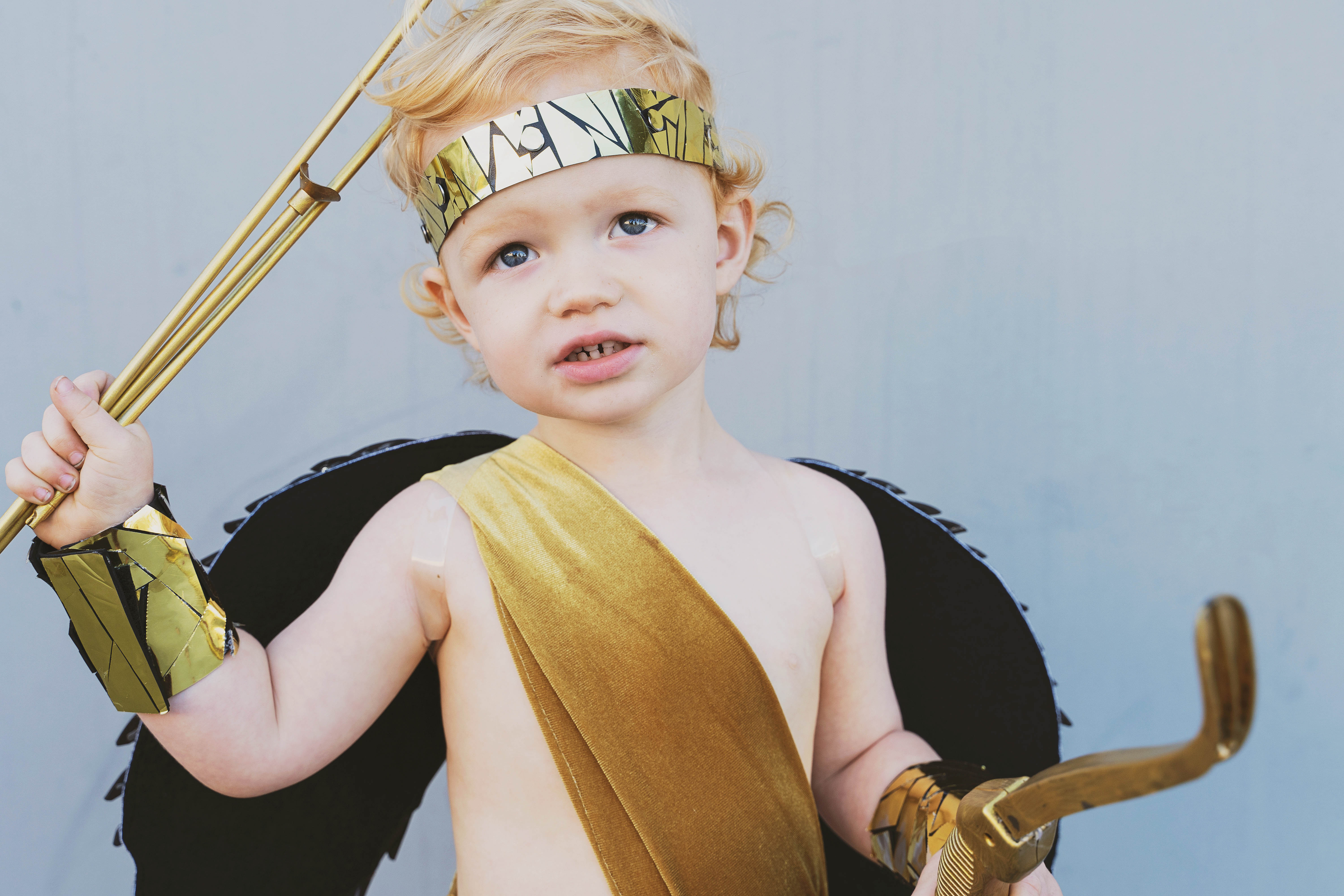 Learn how to make these amazing DIY Greek God Family costumes. They are sure to be a hit this Halloween time. Zeus, Hera, Apollo, Aries, Cupid.